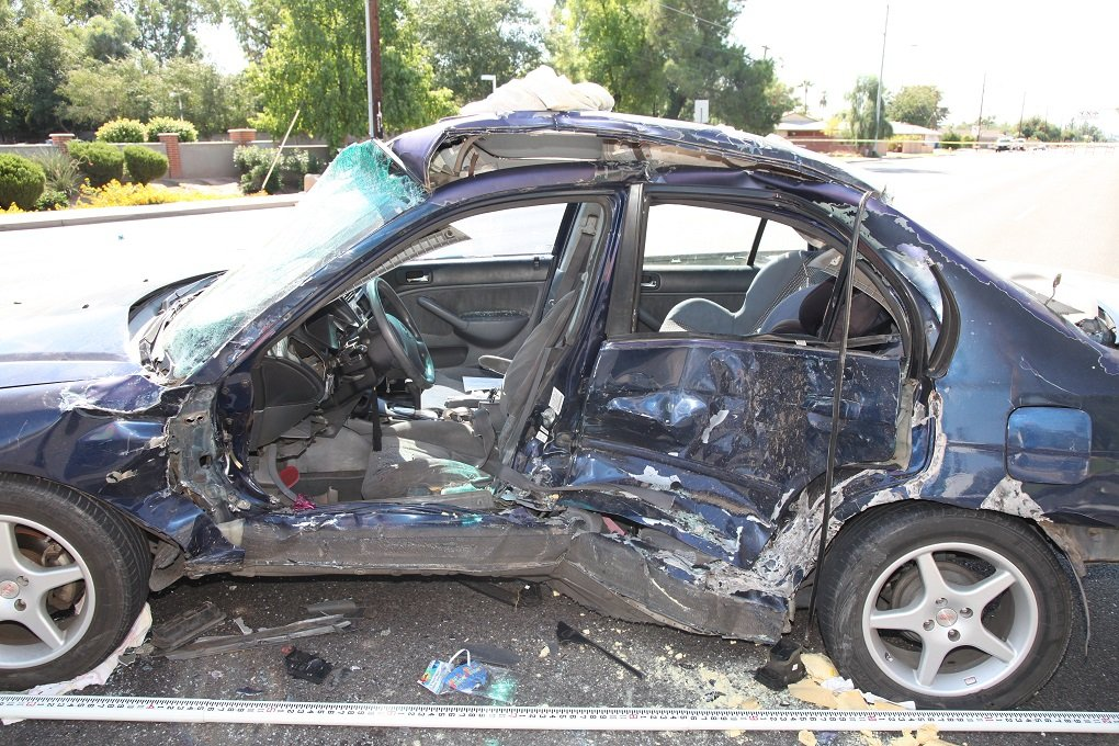 The victim's vehicle was crushed by the impact. (Source: Phoenix Police Department)
