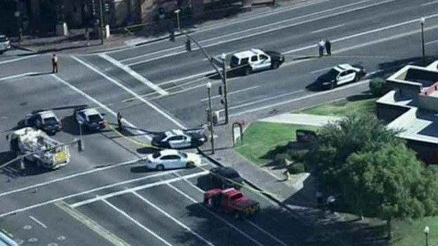 Tempe police investigate the scene of the officer-involved shooting Sept. 12. (Source: CBS 5 News)