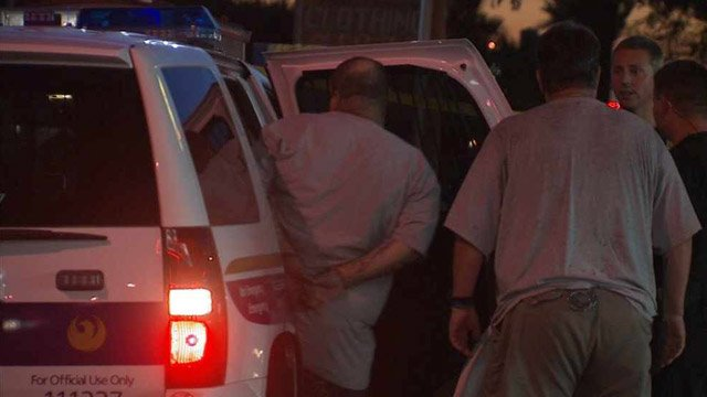 Another suspect gets into a police vehicle. (Source: CBS 5 News)