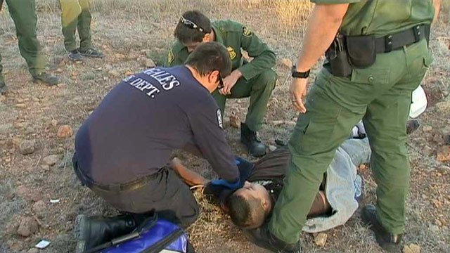 A suspected border-crosser is treated by a paramedic after he's found in southern Arizona. (Source: CBS 5 News)