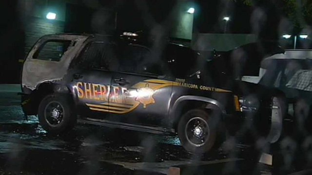 A burned SUV belonging to the Maricopa County Sheriff's Office sits in the lot of a county mechanic shop in Mesa. (Source: CBS 5 News)