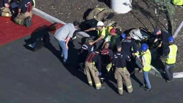 Emergency personnel treat some of the recycling workers who reported feeling ill at plant in the north Valley on Tuesday. (Source: CBS 5 News)