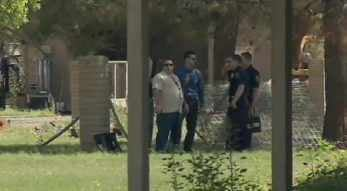 Child dead, babysitter injured in dog attack. (Source: CBS 5 News)