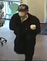 Suspect with surgical mask on his face