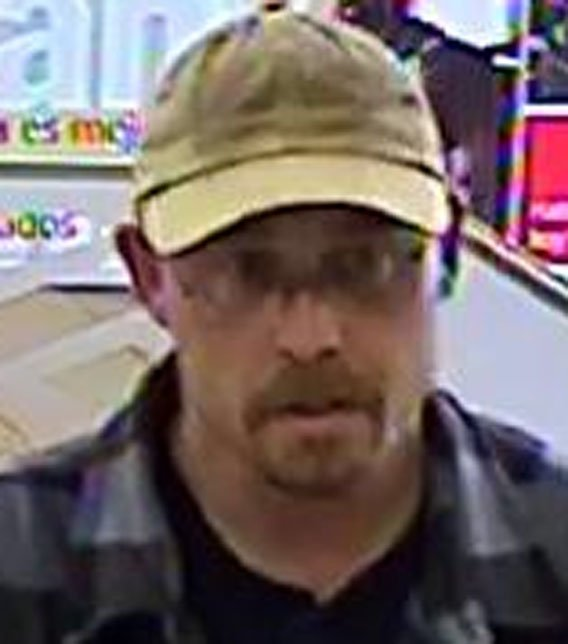 Suspect in Chandler bank robbery remains on the loose. (Source: Silent Witness)