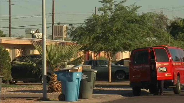 Phoenix police look for clues in a neighborhood where a man was shot and killed during a home invasion Tuesday. (Source: CBS 5 News)