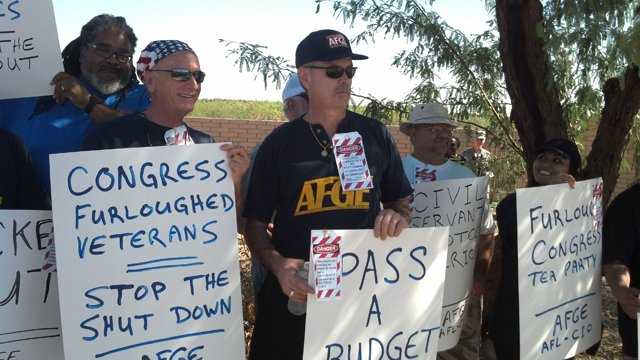 An informational picket Wednesday morning protested the government shutdown. (Source: CBS 5 News)