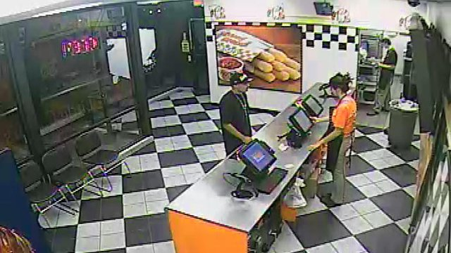 The surveillance photos were taken during the robberies of  Little Caesars in Tempe. (Source: Silent Witness)