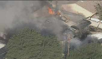 Home catches fire in the 8300 block of Granada in Scottsdale. (Source: CBS 5 News)