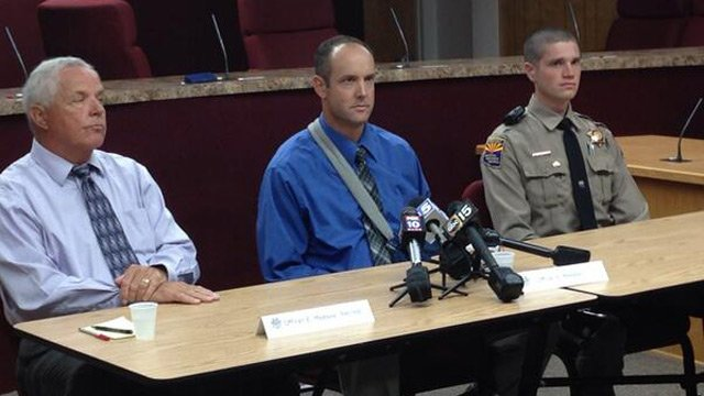 DPS Officer Ernie Meeske, left, his son, DPS Officer Seth Meeske, and DPS Officer Robert Derango at a Thursday news conference. (Source: CBS 5 News)