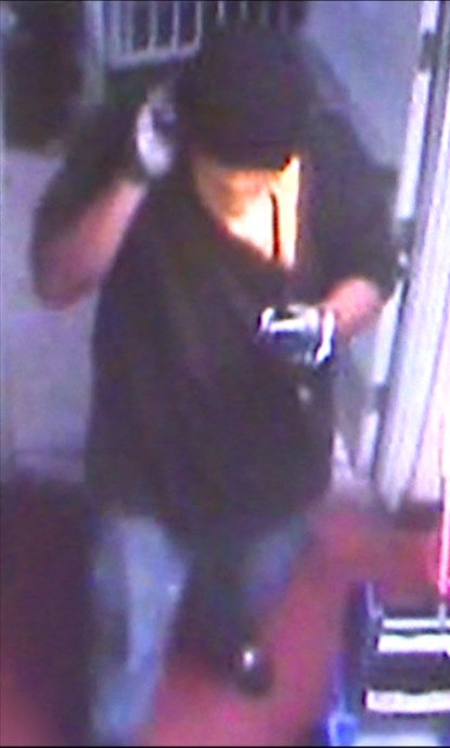 Surveillance image of one of the bandits. (Source: Silent Witness)