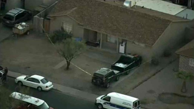 Phoenix police say four men broke into this home and pistol-whipped a woman. She wasn't seriously injured. (Source: CBS 5 News)
