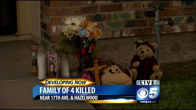 A memorial grows at the slain family's townhouse. (Source: CBS 5 News