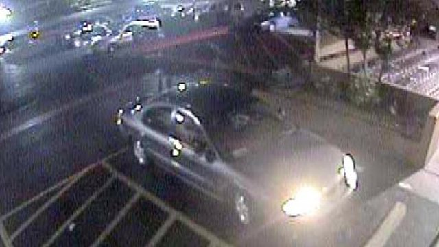 "Two ""persons of interest"" were in this dark-colored, 4-door sedan. (Source: Glendale Police Department)"