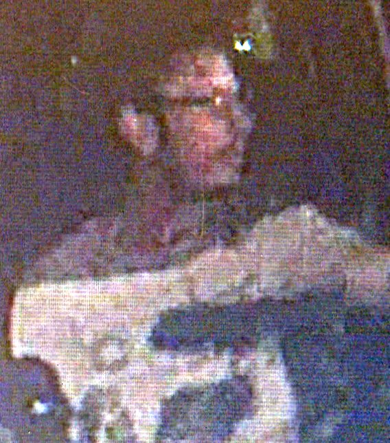 Surveillance image of suspect behind the wheel. (Source: Silent Witness)