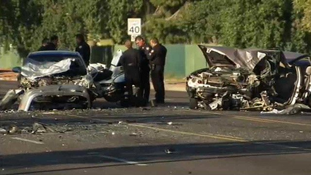 Phoenix police investigate a head-on crash involving three cars on Indian School Road near 61st Drive on Tuesday morning. (Source: CBS 5 News)