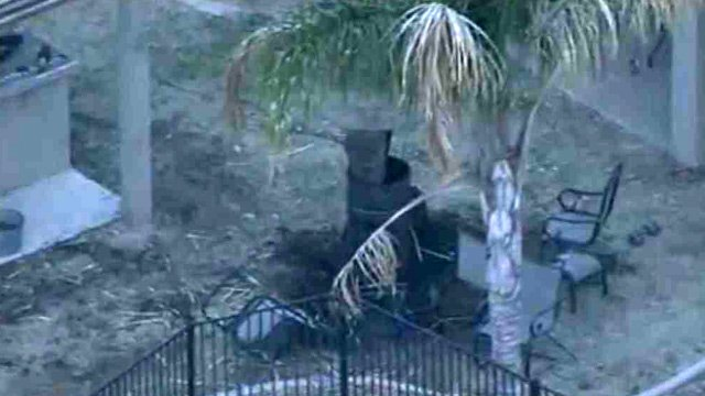 An 11-year-old girl suffered burns over more than half her body when an accelerant was poured onto a bonfire in this Queen Creek yard Tuesday night. Six people in all suffered burns. (Source: CBS 5 News)