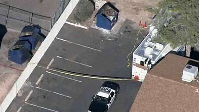 Mesa police in the parking near a Dumpster in which Claudia Lucero's body was found Friday morning. (Source: CBS 5 News)