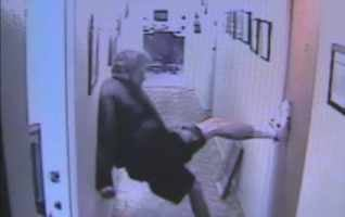 A suspect is caught on camera trying to break into Korean Community Center.