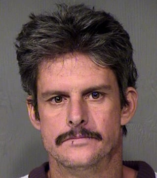 Mark Dollar, 38, was arrested Thursday in connection with the theft Salvation Army donations last week. (Source: Maricopa County Sheriff's Office)