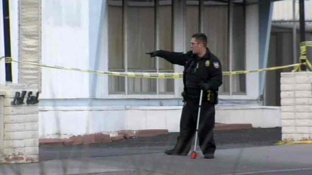 A Phoenix police officer works the scene of a fatal shooting Sunday. (Source: CBS 5 News)
