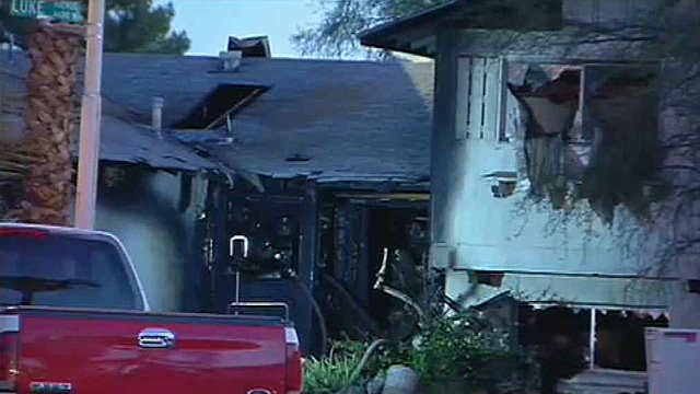 A fire badly damaged this Glendale home. Firefighters had to battle through the possessions of a hoarder. (Source: CBS 5 News)