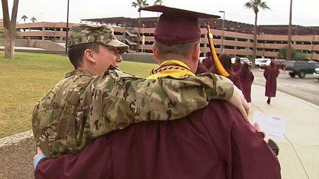 U.S. Army Spc. Tina Halvorsen walks with her best friend, Allen Montenegro, to his graduation ceremony from ASU. (Source: CBS 5 News)