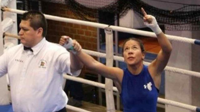 Sulem Urbina honors her brother after each bout by pointing to the sky. (Source: Urbina family photo)