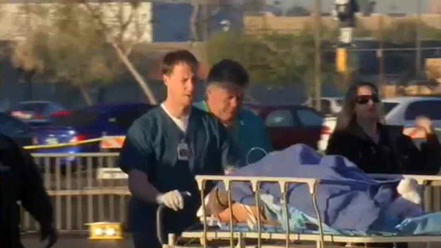 One of two armed robbery suspects shot by a Pinal County deputy is wheeled into Maricopa Medical Center on Monday. (Source: Todd Jackson / CBS 5 News)