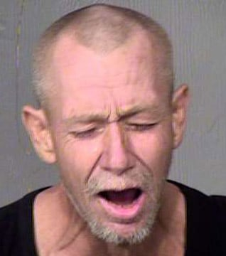Robert Bump was arrested after he was caught running onto a taxiway and beating on a Southwest Airlines plane at Phoenix-Sky Harbor International Airport. (Source: Maricopa County Sheriff's Office)