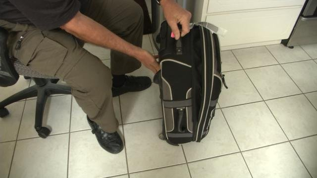 frontier customers can pay expensive carry on bag fees
