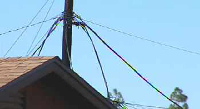 Downed power lines hampered firefighters. (Source: CBS 5 News)