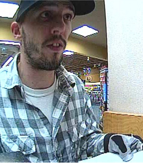 Surveillance image of suspect at US Bank branch at 4005 E. Chandler Blvd. in Phoenix on Dec. 24.. (Source: SIlent Witness)