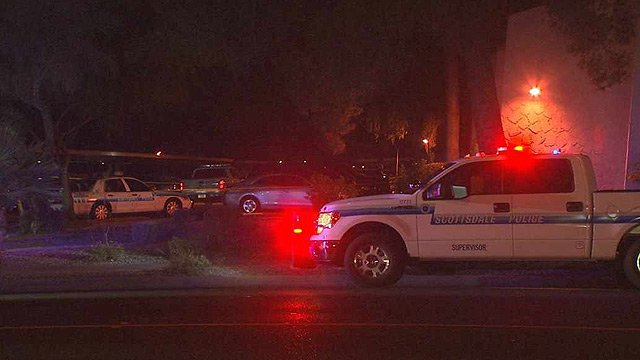 Scottsdale police sit outside a condominium complex where officers shot and killed a man armed with a shotgun. (Source: CBS 5 News)