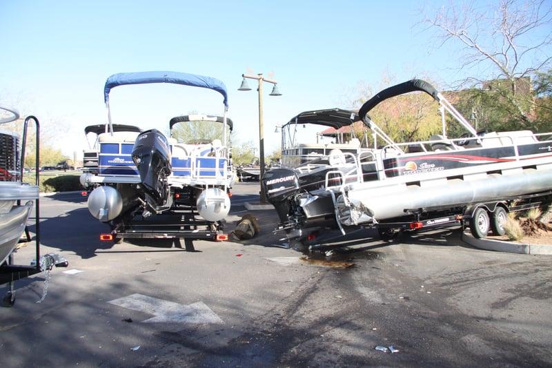 Pd driver hits several boats in mesa store lot arizona for Red mountain motors mesa az