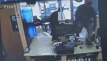 Surveillance image capturing the robbery in progress. (Source: Peoria Police Department)