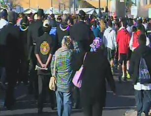 Marchers walk down Washington street towards the heart of downtown (Source: CBS 5 News)