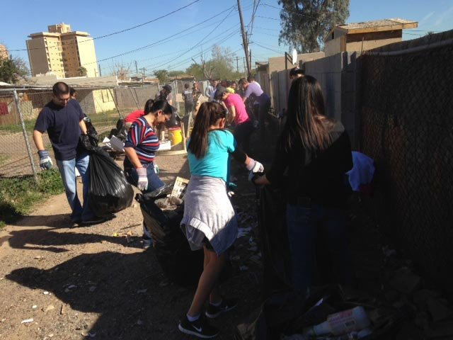Volunteers help clean up an area of Mesa on Monday. (Source: CBS 5 News)