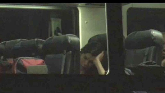 A passenger rests on one of the relief buses sent by Greyhound to bring passengers to Phoenix. (Source: CBS 5 News)