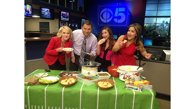 Katie Baker, left, Pat McReynolds, Nadine Bubeck and Nicole Crites sample the Morning Show's Super Bowl potluck fare. (Source: CBS 5 News)