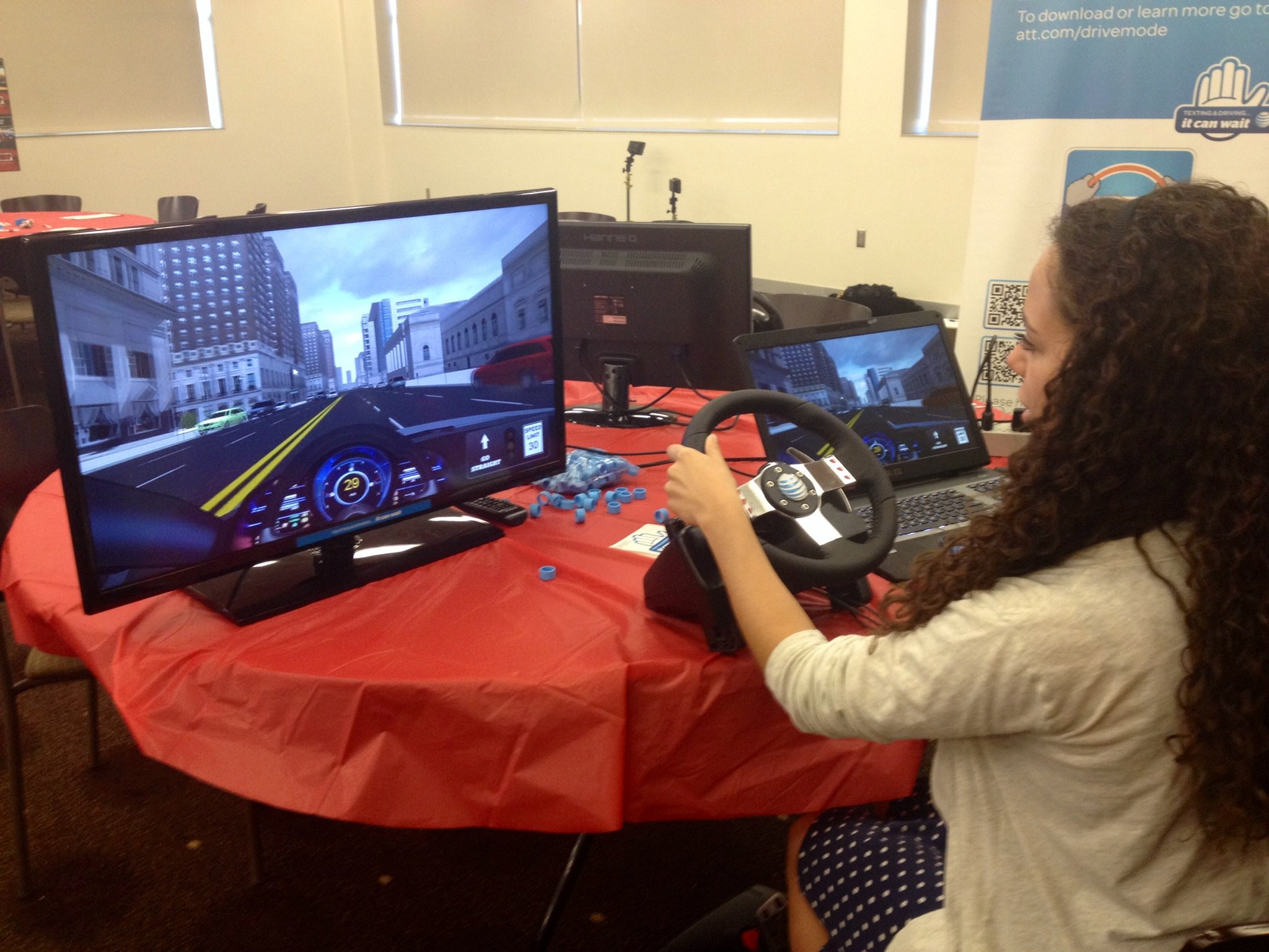 Student tests out driving simulator
