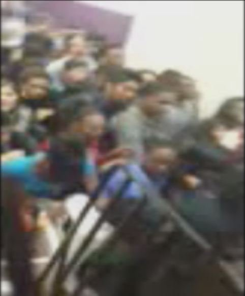 Cell phone video shows chaotic aftermath of shooting.