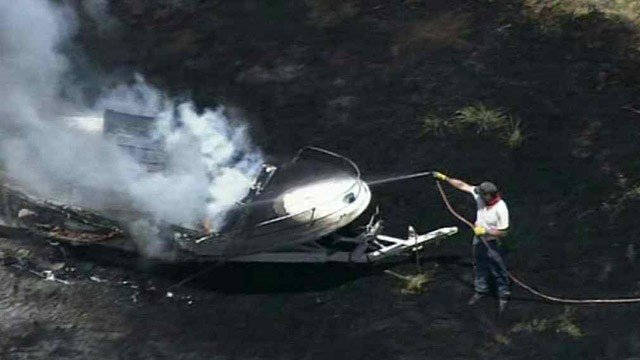 This boat was overtaken by flames just before noon Friday in a lot in Avondale.