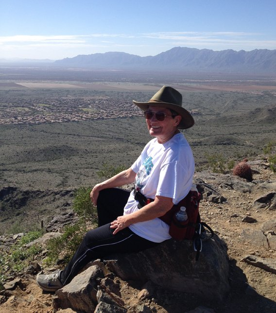 Photo of Pat Lawlis at the top of the Pyramid Trail, looking out over the western end of Ahwatukee. (Source: Pat Lawlis)
