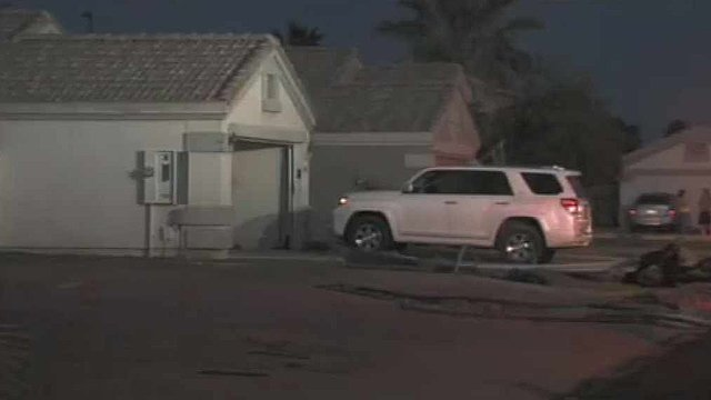 © The garage door of this Gilbert home was blown out and a man severely burned when he lit a cigarette and sparked an explosion Sunday afternoon. (Source: CBS 5 News)