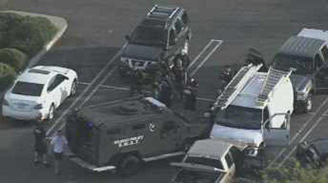 SWAT officers respond to the Food City parking lot in Scottsdale. (Source: CBS 5 News)