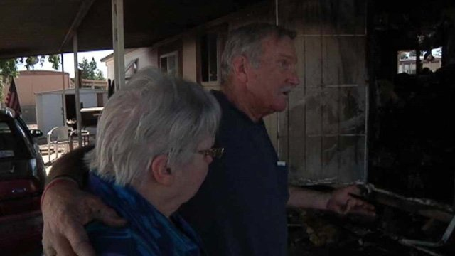 Marcia and Bob Collier told CBS 5 News they were sound asleep when someone started banging on their door around 5 a.m. and alerted them to a fire in their mobile home. (Source: CBS 5 News)