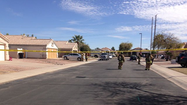 Hazmat crews on Thursday returned to the Gilbert neighborhood. (Source: CBS 5 News)