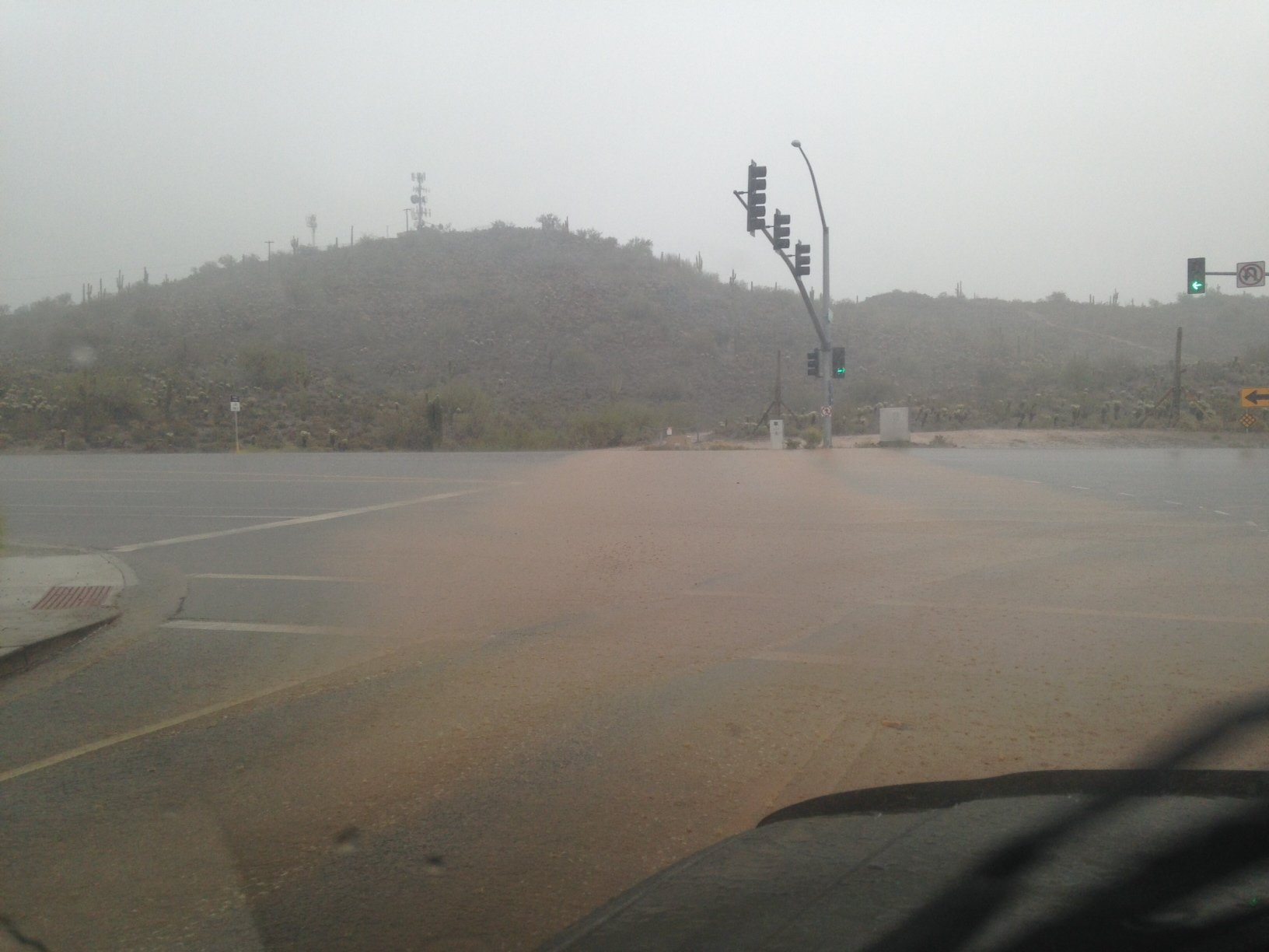 Running water flows across Gavilan Peak Parkway at the Pioneer Road exit in Anthem. (Source: Sean Gates, cbs5az.com)