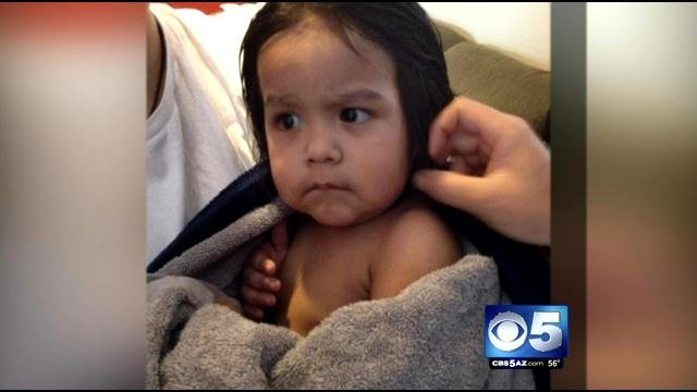 The child, who appeared to be about 2 years old, was found by the home's residents Saturday morning. (Source: Phoenix Police Department)